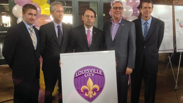 Owner Wayne Estopinal (center) poses with Mayor Greg Fischer, Coach James O'Connor (left), OCSC Owner Phil Rawlins (center right) and USL President Tim Holt (right) after Louisville City FC's official announcement.
