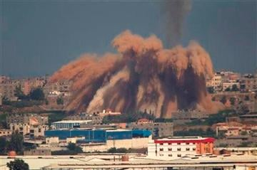 (AP Photo/Ariel Schalit). Smoke and debris rise after an Israeli strike on the Gaza Strip seen from the Israeli side of the Israel-Gaza Border, Wednesday, July 9, 2014.