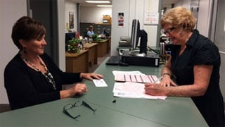 Jan Scholtz (right) files to run for the District 3 seat on the Jefferson County Board of Education on Tuesday, July 15, 2014.