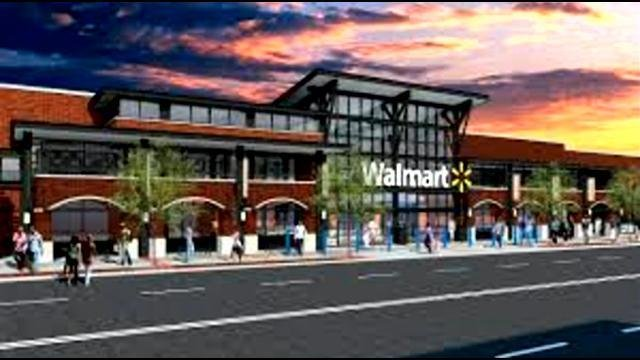 This is an example of what an urban storefront would look like for a Wal-Mart in that location.