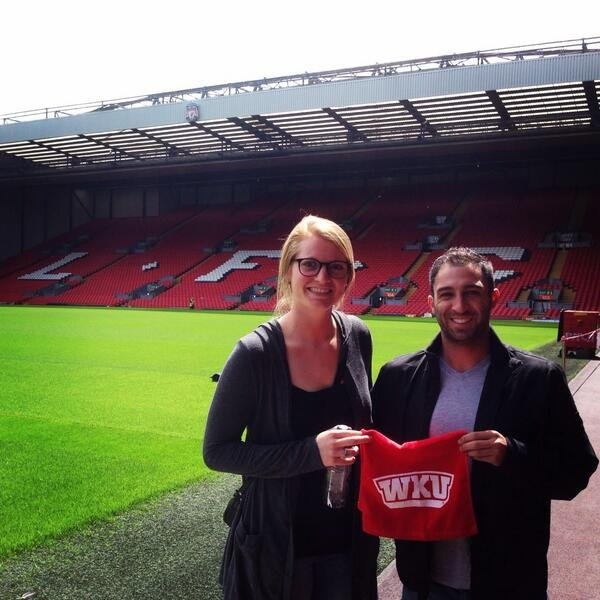 Stout poses with WKU assistant coach Dustin Downey at Anfield in Liverpool.