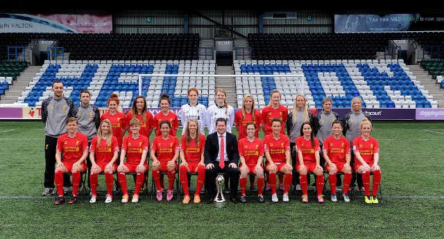 Stout at top row, center with her teammates at Liverpool Ladies FC.