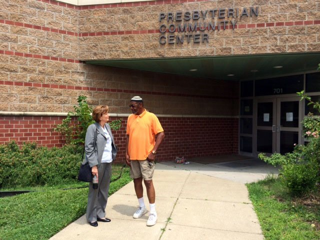 JCPS Superintendent Donna Hargens chats with James Moore outside the Presbyterian Community Center on July 24, 2014.