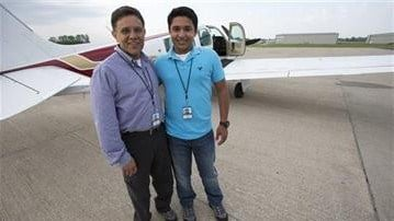 Babar Suleman and his son in front of their plane. Image Courtesy: AP