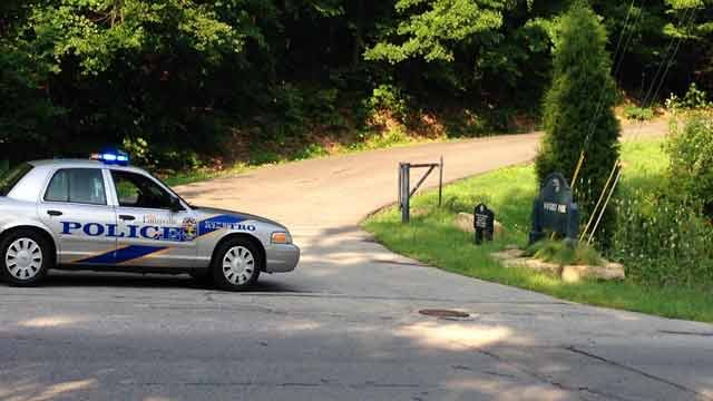 Police blocked the entrance to Waverly Park early on July 29 while searching for an armed robbery suspect.