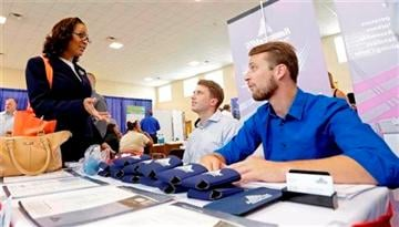(AP Photo/Alan Diaz). In this photo taken Wednesday, July 16, 2014, job seeker Staci Sudduth, left, talks to job recruiters Cameron Quin, center, and Jay Kington, right, at a Hiring Fair For Veterans in Fort Lauderdale, Fla.