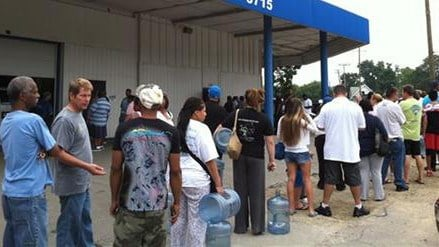 Residents in Toledo line up for water on Saturday, Aug. 2, 2014, in Toledo, Ohio. (AP Photo/The Blade, Jetta Fraser)