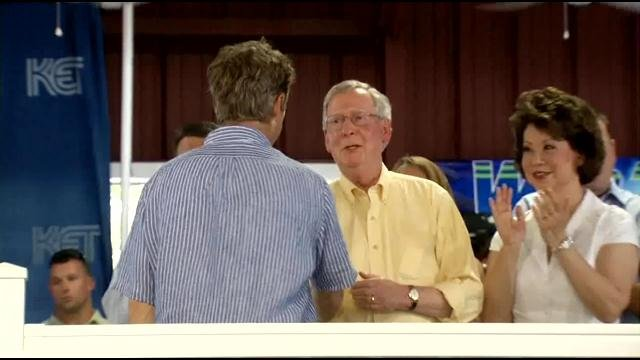 Mitch McConnell greets Rand Paul at Fancy Farm 2014.