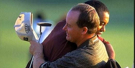 Bob May and Tiger Woods hug after Woods won the 2000 PGA in a playoff.