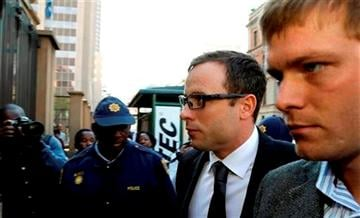 (AP Photo/Themba Hadebe). Oscar Pistorius, second from right, accompanied by a relative arrives at the high court in Pretoria, South Africa, Thursday, Aug. 7, 2014.