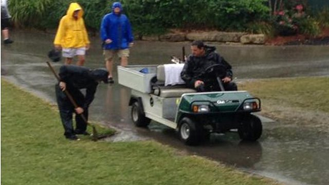 Valhalla crews work to clear drains of standing water after heavy rains Friday morning.