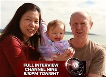 """(AP Photo/Channel 9 60 Minutes). In this image taken from video supplied Sunday, Aug. 10, 2014 by Channel 9's """"60 Minutes"""", David Farnell, right, his wife Wendy, left, pose with baby Pipah in Australia."""