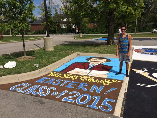 Reed Hutchinson poses with his Ron Burgundy-themed parking spot.