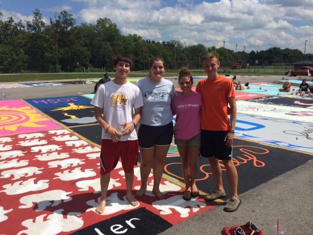Seniors Austin, Emily, Lauren & Tyler pose in front of their spots.