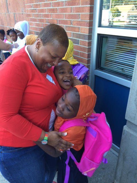 Camp Taylor Elementary teacher Valerie Mayfield hugs a student excited to see her on the first day.