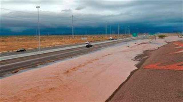 Flash flood waters from the overrun Skunk Creek flood I-10, Tuesday, Aug. 19, 2014, in northwestern Phoenix.