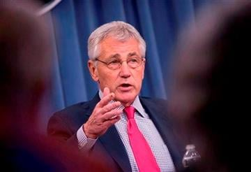 (AP Photo/Pablo Martinez Monsivais, File). FILE - This July 3, 2014 file photo shows Defense Secretary Chuck Hagel speaking at the Pentagon.