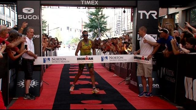 Chris McDonald, of Australia, collapses as he wins the 2014 Ironman Triathlon in Louisville. He said the heat and humidity played a role in his exhaustion after the race.