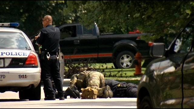 Officers were called to a house where a man was on his porch, threatening suicide.