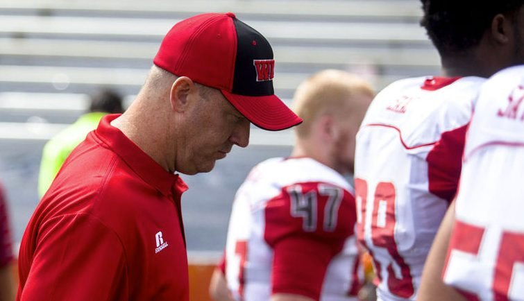 First-year WKU coach Jeff Brohm walks off the field after his team's 42-34 loss at Illinois. (AP Photo)