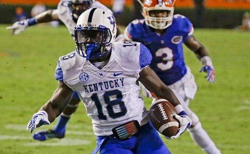 """Stanley """"Boom"""" Williams scores in the first overtime period in UK's loss at Florida. (AP photo)"""