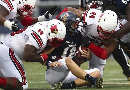 The U of L defense led the way in its win at FIU. (AP Photo)