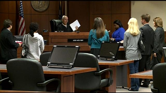 Suspects appear in court.