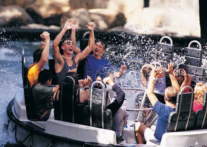 Try to stay dry while navigating the wilderness waterways the Raging Rapids River Ride!