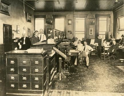 Brown-Forman founder George Garvin Brown, far right in dark suit, at 117 W. Main Street in Louisville in 1904 (Brown-Forman photo)