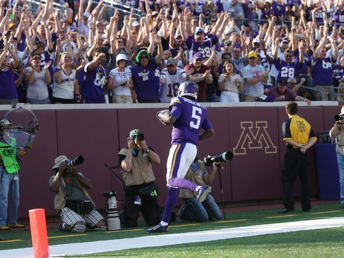 Fans cheer Teddy Bridgewater's first NFL touchdown. AP photo.