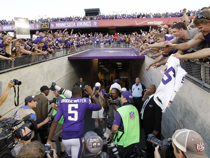 Teddy Bridgewater cheered on by Minnesota fans after his first NFL start. AP photo.