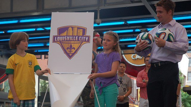 Louisville City's logo is unveiled during a USA World Cup game over the summer.
