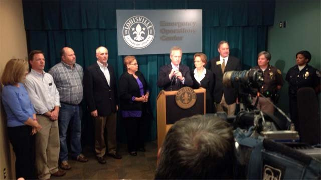 Mayor Greg Fischer and city officials discuss the city's response to a shooting at Fern Creek High School.