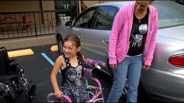 Shyanne leaves the hospital with her walker.