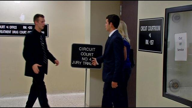 Garreth Stephens (left) and Jared Sowders (right) shake hands outside the courtroom.