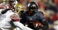 Louisville halfback Michael Dyer scored three touchdowns against Florida State.