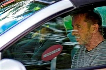 (AP Photo/Bay Of Plenty Times via The New Zealand Herald, George Novak). Phil Rudd, the drummer for rock band AC/DC, leaves a court house in Tauranga, New Zealand, Thursday, Nov. 6, 2014, after being charged with attempting to procure murder.