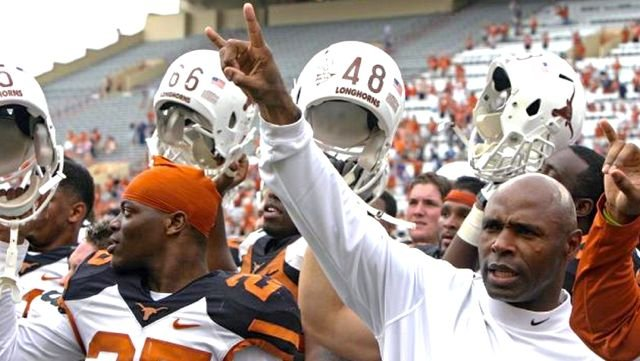 Former Louisville coach Charlie Strong needs to win two of his last three games to avoid a losing season at Texas.