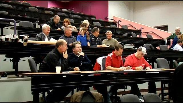 Citizens listen to explanations of the plans to re-do Dixie Highway at the meeting Tuesday night, Nov. 11, 2104.