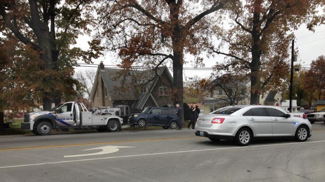 A police wrecker tows the suspect's car after a brief police pursuit.