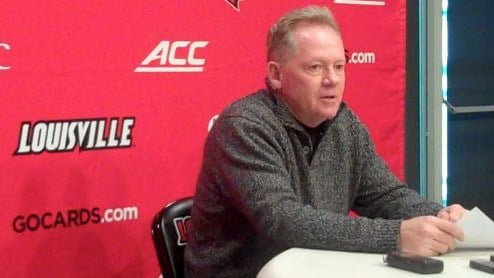 Louisville football coach Bobby Petrino grew up watching Notre Dame football replays.