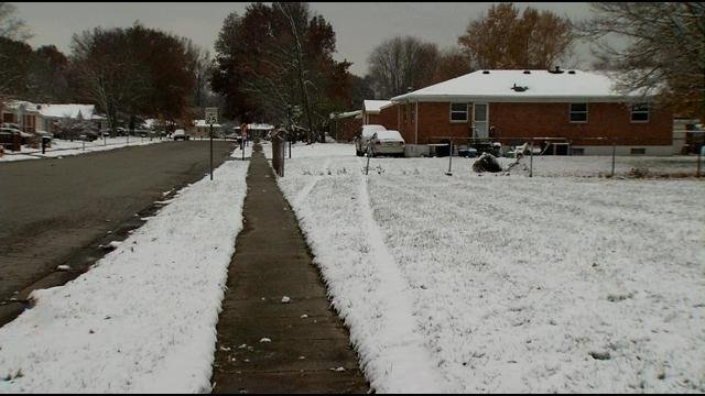 Tire tracks could be seen in the snow the morning after a cab driver was shot and his car careened through this yard.
