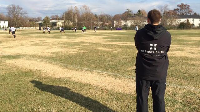 Team trainer Scott Ritter, with Baptist Health, looks on.