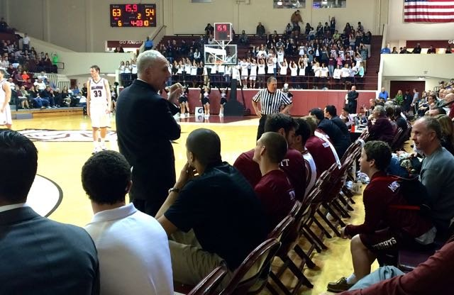 Bellarmine coach Scott Davenport talks with Patrick McSweeney behind the bench in the closing seconds of the Knights' win over Findlay. (WDRB Photo by Eric Crawford).