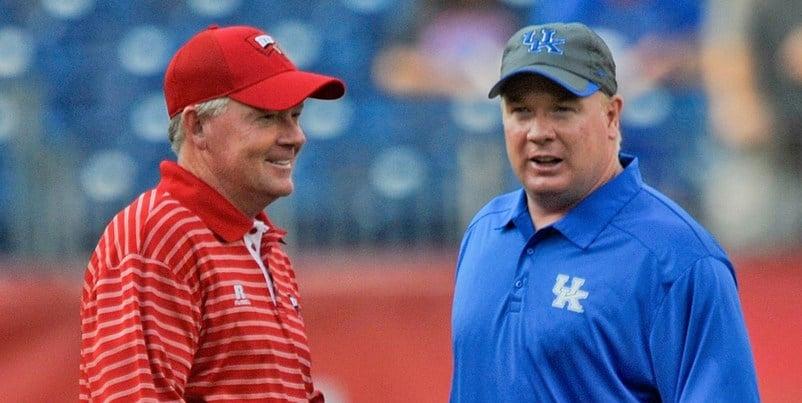 Bobby Petrino (left) and Mark Stoops met last season when Petrino coached Western Kentucky.
