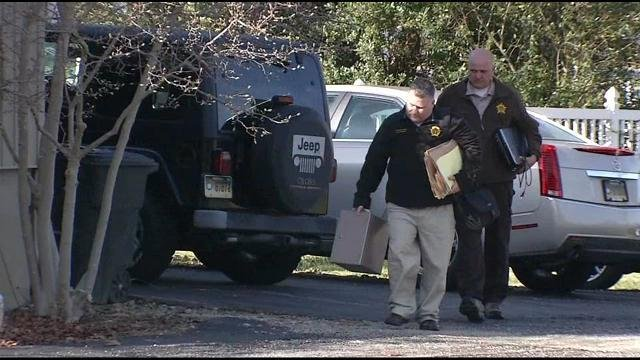 Investigators carry evidence out of Southeast Bullitt Fire Chief Julius Hatfield's residence on Tuesday, Nov. 25.