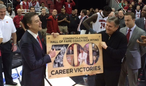 Louisville athletic director Tom Jurich (right) helped Rick Pitino celebrate his 700th victory Wednesday night.