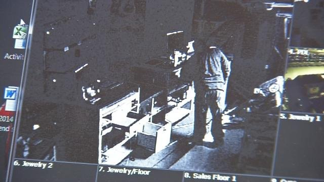 Surveillance footage of the suspect who broke into the Cash America through the roof.