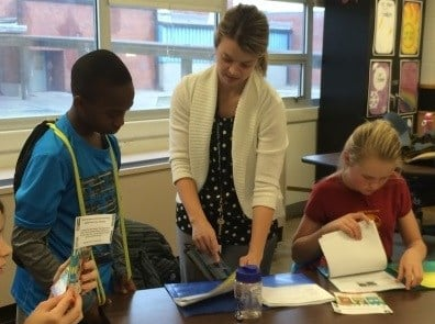 Westport Middle School teacher Sharon Klump works with two of her students on Tuesday. She is one of 52 JCPS teachers to obtain National Board Certification in 2014.