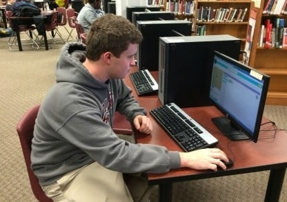 "Ballard High School senior Alex Ferne learns about coding during ""Hour of Code"" event being held this week"